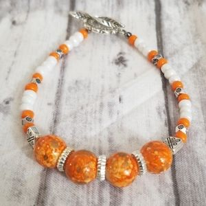 Orange & white glass beaded bracelet